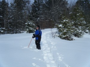 Marie snowshoeing in deep snow.